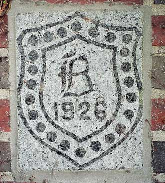 The 1926 ivy stone is on the Alumni Gymnasium facing the Muskie Archives.