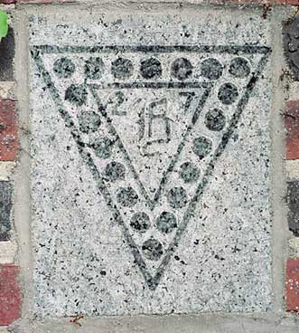 The 1927 ivy stone is on the Alumni Gymnasium facing Muskie Archives.