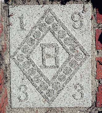 The 1933 ivy stone is on the Gray Cage facing the Library Quad.