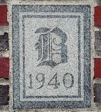 The 1940 ivy stone is on the Alumni Gymnasium facing Ladd Library.