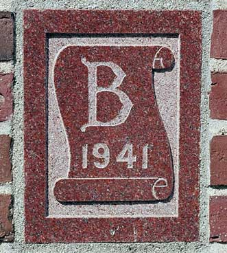 The 1941 ivy stone is on Smith Hall facing Garcelon Field.