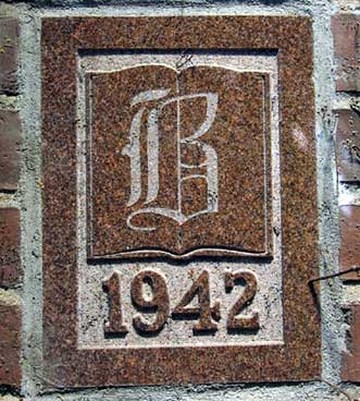 The 1942 ivy stone is on Smith Hall facing Garcelon Field.
