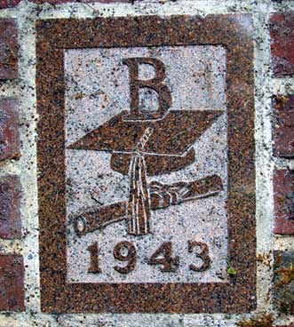 The 1943 ivy stone is on Smith Hall facing Garcelon Field.