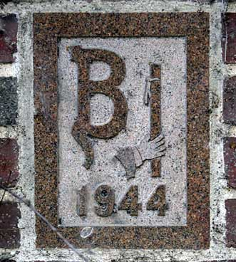 The 1944 ivy stone is on Smith Hall facing Garcelon Field.
