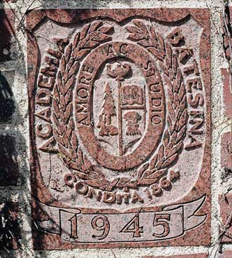 The 1945 ivy stone is on Smith Hall facing Garcelon Field.