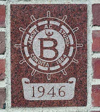 The 1946 ivy stone is on Smith Hall facing Garcelon Field.