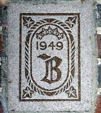 The 1949 ivy stone is on the Alumni Gymnasium facing the Muskie Archives.