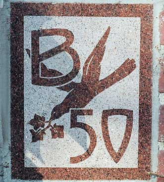 The 1950 ivy stone is on the Alumni Gymnasium facing the Muskie Archives.