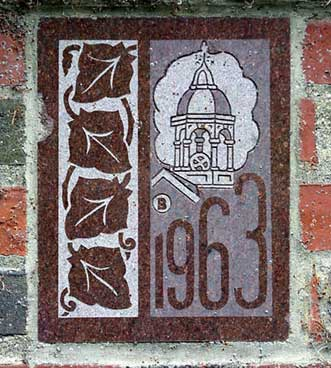 The 1963 ivy stone is on the Gray Cage facing Ladd Library.