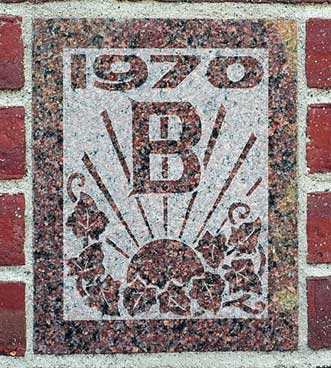 The 1970 ivy stone is on Dana Chemistry Hall facing Hedge Hall.