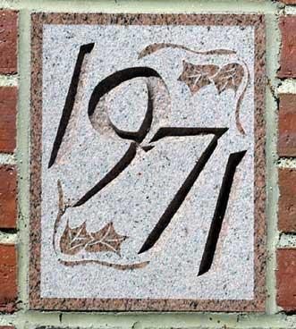 The 1971 ivy stone is on Dana Chemistry Hall facing Hedge Hall.