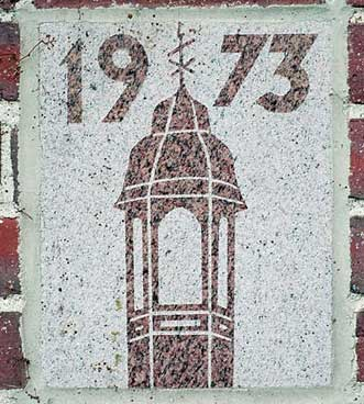 The 1973 ivy stone on the Historic Quad side of Dana Chemistry Hall facing Hedge Hall.