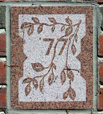 The 1977 ivy stone is on Dana Chemistry Hall facing the Historic Quad.