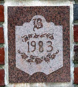 The 1983 ivy stone is on Chase Hall facing Carnegie Science Hall.