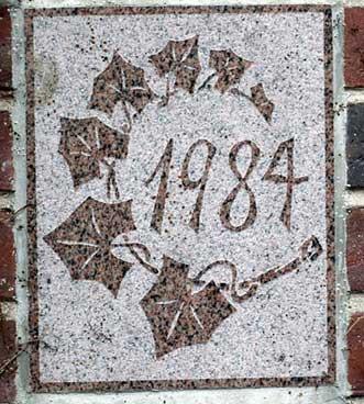 The 1984 ivy stone is on Lane Hall facing Alumni Walk.