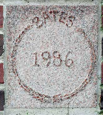 The 1986 ivy stone is on Chase Hall facing Carnegie Science Hall.