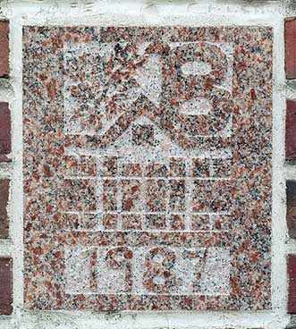 The 1987 ivy stone is on Chase Hall facing Carnegie Science Hall.