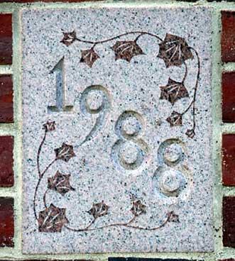 The 1988 ivy stone is on Lane Hall facing Alumni Walk.