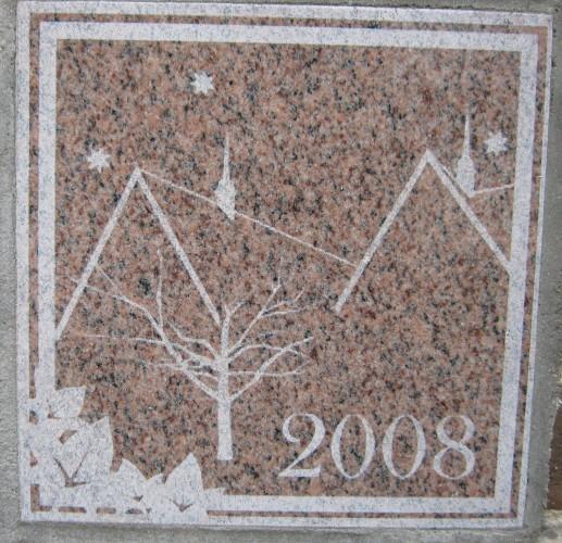 The 2008 ivy stone is on the Alumni Walk side of Pettengill