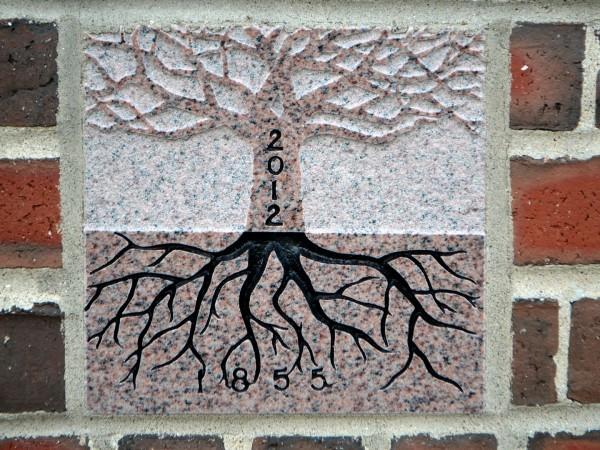 The 2012 ivy stone is on the Alumni Walk side of Pettengill