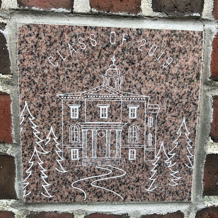 The 2019 ivy stone is on the Alumni Walk side of Pettengill