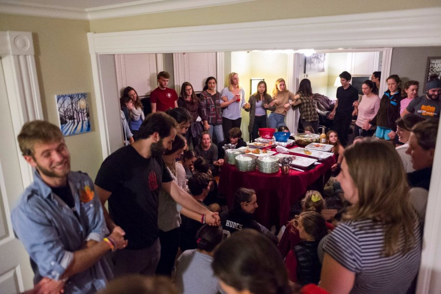 "Students gather before sharing a meal and queries at ""Hearth"" in the home of Multifaith Chaplain Brittany Longsdorf"