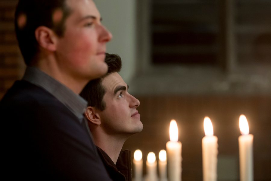 """""""Students gather this evening in the Peter J. Gomes Chapel for """"Candles and Carols,"""" the annual candlelit service of communal singing, reflective readings from many traditions, and musical offerings by the Bates College Choir, Bates acapella groups, Mark Su'22, Amelia Keleher '21, and Music Director/Organist John Corrie. The evening was sponsored by the Bates College Multifaith Chaplaincy."""