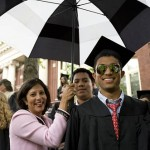 Justin HoShue '09 and his family find protection from the sudden downpour that interrupts the last portion of the Baccalaureate service.