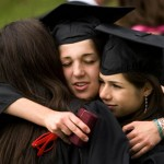 Alexis Smith '09 (center) embraces Caryn Benisch '09 (left) and Rebecca Cotugno '09 (right) before the friends head to their alphabetically determined places in the Commencement procession.