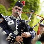 Piper Rob Simmons plays during the processional on the steps of Hathorn Hall.