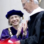 President Hansen applauds as Ralph Perry '51, doctor of humane letters, completes his Commencement address.