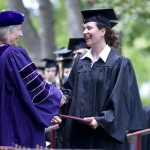 President Hansen awards Sabrina Miess a bachelor of arts, summa cum laude, in psychology.