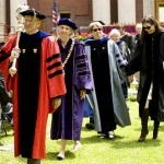 The academic procession departs the Quad.
