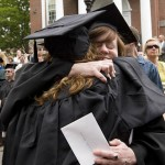 Assistant Professor of Theater Christine McDowell shares a goodbye with graduate Kolby Hume '09.