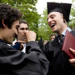 From left, Ru Hasanov '09 (joined by brother Kamal) celebrates with Matt Paul '09.