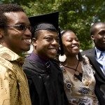 Theodore Sutherland '11(left) and Patrick Williams '11 (right) offer congratulations to friend Donelle Durham '09.