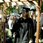 Ian Jones '04 touches a wind chime hanging from a Baccalaureate archway at the conclusion of the service.