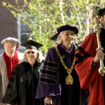 Mace Bearer Sawyer Sylvester and President Hansen lead the honorary degree recipients onto the Quad.