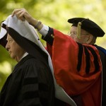 Professor of Sociology Sawyer Sylvester places an honorary degree hood on historian David McCullough.
