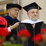 Professor of Sociology Sawyer Sylvester places an honorary degree hood on Eric Carle.