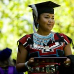 Wearing traditional Navajo attire, Cynthia Freeman '06 walks across the Coram stage after receiving her diploma.