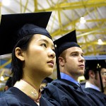 Graduates wait with anticipation to be called for their degrees.