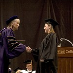 President Hansen congratulates one of 517 graduates.