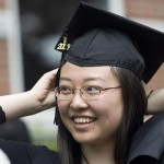 Grace Liu '06 adjusts her mortarboard during the Ivy Stone ceremony.