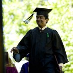 Bill Jack '08 of Bowdoin, Maine, greets Bates College Trustees as he crosses the stage.