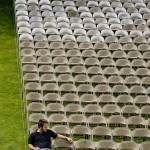 A lone figure among the folding chairs arranged on the historic Quadrangle, Jon Duchette '06 arrives early for Friday afternoon's Commencement rehearsal.