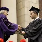 President Hansen congratulates newly minted graduate Alan Cooper.