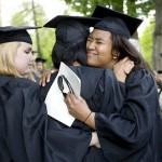 Tamara Wyche '08 of Baltimore, Md.(right), shares an emotional moment with classmates at Baccalaureate's conclusion.