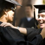 A day before Commencement, friends reach for each other as unofficial goodbyes begin.