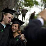 Antonio Fermin photographs his daughter Sela Fermin '08 of Sag Harbor, N.Y., with Jamie Lynch '08 of Cambridge, Mass. The green ribbons signify the Class of 2008's graduation pledge of social responsibility.